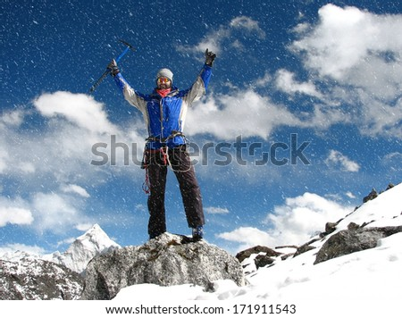 The mountaineer at the top of the world, Mount Everest,Himalayas - stock photo