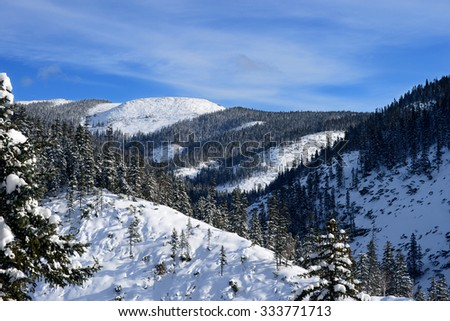 The mountains around Lake Amut.Winter forest in the mountains. - stock photo