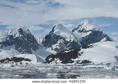 The mountains on the coast of the Antarctic Peninsula - 4. - stock photo