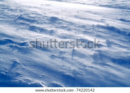 The movement of snow at the time of snowstorm. - stock photo