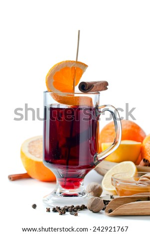 The mulled wine with spices and fruits  isolated on white - stock photo