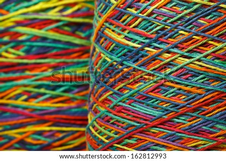 The multicolored yarn used for knitting clothes - stock photo