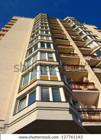 The multistorey modern house on the blue sky background - stock photo