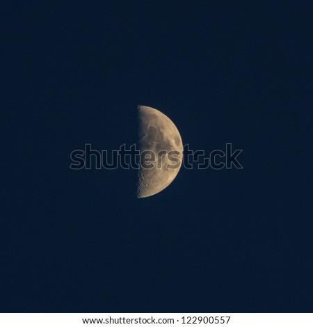the mystery half moon at the night sky - stock photo