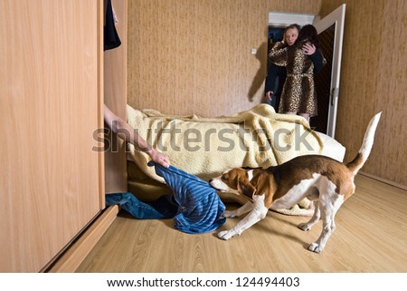 The naked lover in a wardrobe - stock photo