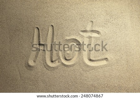 the name and designation drawn in the sand - stock photo