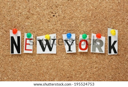 The name New York in cut out magazine letters pinned to a cork notice board - stock photo