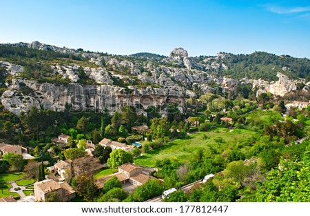 The narrow Fontaine Valley between Alpilles hides cozy cottages, green gardens and old villas, Les Baux-de-Provence, France. - stock photo