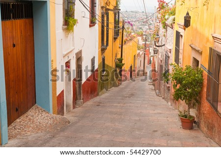 The narrow, hillside  streets of colorful San Miguel Allende Mexico - a World Heritage Site - stock photo