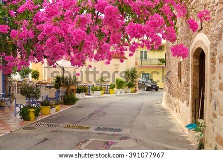 The narrow street in the old part of Malia, Crete, Greece. - stock photo