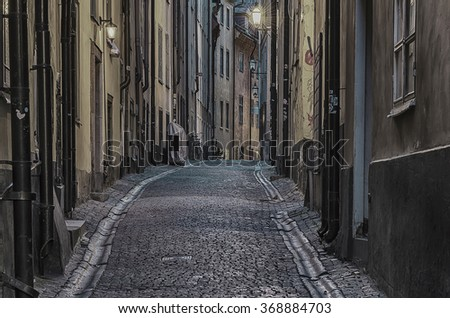 The narrow street of Gamla Stan - historic city old center of Stockholm, at summer night -  monochrome desaturated style - stock photo