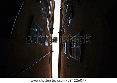 The narrowest alley in Stockholm: Marten Trotzigs alley in the Gamla Stan (The Old Town) area of Stockholm, Sweden.  January 06, 2013 - stock photo