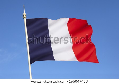The national flag of France is a tricolor featuring three vertical bands colored royal blue, white, and red. It is known to English speakers as the French Tricolor  - stock photo