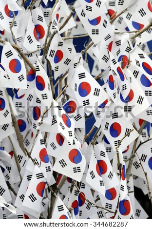 The national flag of South Korea. With a red and blue Taiji yin- and yang-symbol in the center, and four black trigrams, which are selected from the original eight, on each corner of the flag. - stock photo