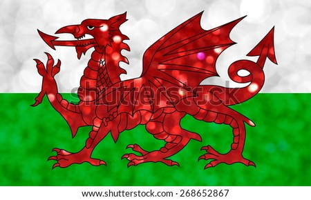The National flag of Wales made of bright and abstract blurred backgrounds with shimmering glitter - stock photo