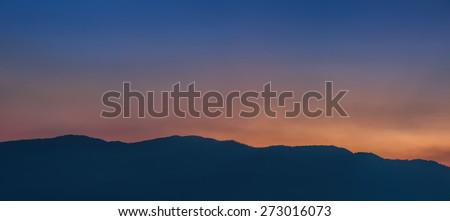The nature landscape of twilight sky and mountain - stock photo