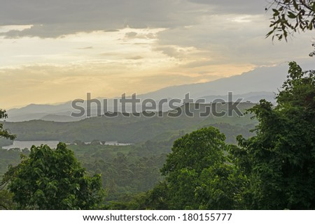 The Ndali Crater Lakes and the Rwenzori Mountains at Sunset - stock photo