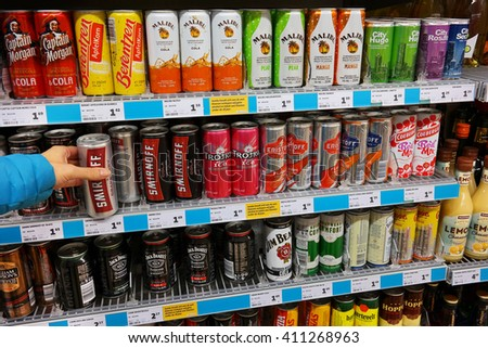 THE NETHERLANDS - OCTOBER 31, 2015: Shelves with Alcopop in a Jumbo supermarket. Coolers are certain flavored alcoholic beverages with relatively low alcohol content. - stock photo