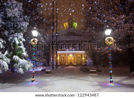 The Nevada state Capitol Building, in Carson City, Nevada. Christmas lights in the middle of a snowstorm. - stock photo