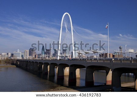 The new Continental Pedestrian and Margaret Hunt Hill Bridges that cross the Trinity River in Dallas, Texas. The bridge uses a unique design of a 400-foot steel arch and cables to support the bridge. - stock photo