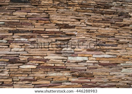 The new design of modern wall Rock stone brick tile wall aged texture detailed pattern background in light yellow cream brown color tone: Grunge ancient rustic limestone patterned backdrop - stock photo