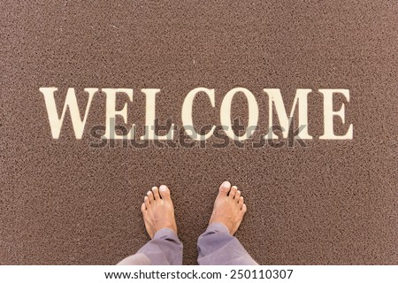 The new doormat of welcome text. - stock photo
