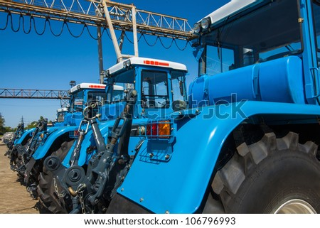 The new tractors in the parking lot - stock photo