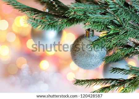 The New year's balls on branch spruce on blur background. - stock photo