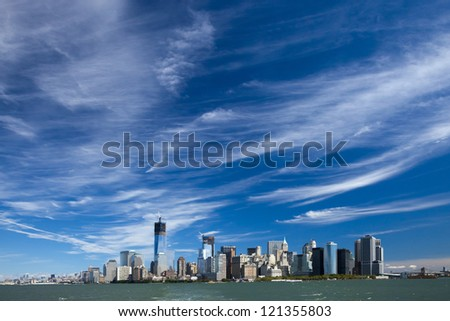 The New York City skyline at afternoon w the Tower 4 and Freedom tower under construction - stock photo