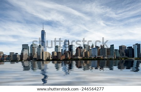 The New York City skyline at afternoon with the Freedom tower - stock photo