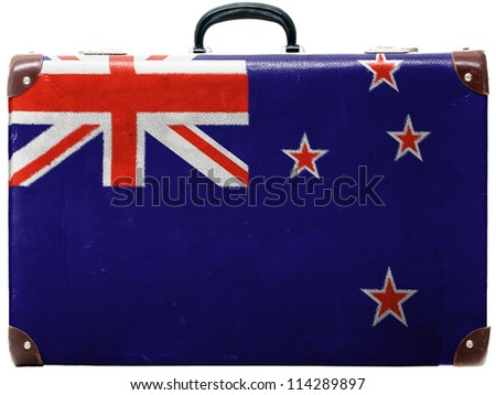 The New Zealand flag painted on  old grungy travel suitcase or trunk - stock photo