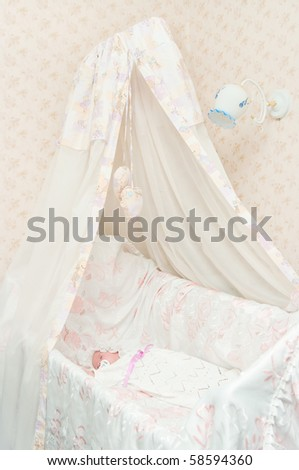 The newborn child in a bed with a canopy - stock photo