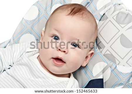 the newborn, in a chair for feeding - stock photo