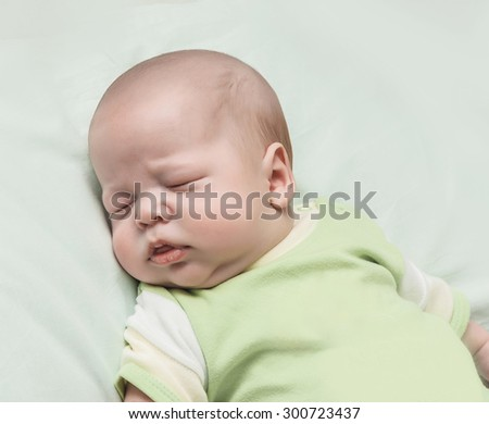 The newborn one-month baby sleeps - stock photo