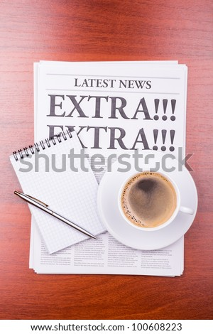 The newspaper LATEST NEWS with the headline EXTRA! EXTRA!  and coffee - stock photo