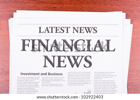 The newspaper LATEST NEWS with the headline  FINANCIAL NEWS - stock photo