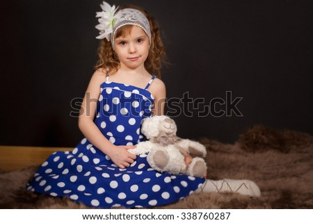 the nice girl on a black background   - stock photo