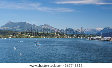 The nice view from the famous Haldenstrasse at the shores of Lake Lucerne (Vierwaldstattersee) towards Inseli Park and the Burgenstock Resort further away on the other side of the shore . - stock photo