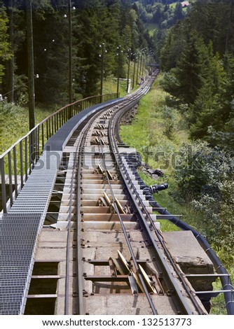 The Niesen funicular runs on steep metal rails, but there are no cogs. - stock photo