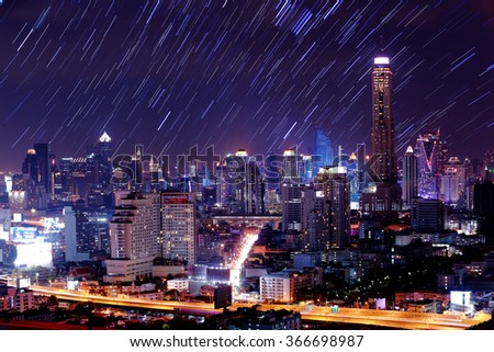 The night sky , the stars and the Tallest building in the city. - stock photo