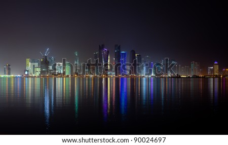 The night skyline over the persian gulf of the city of Doha, Qatar - stock photo
