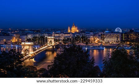 The night view of the Chain bridge, Saint Istvan's basilica and the Danube in Budapest from the Buda castle area  - stock photo