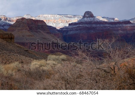 The North Rim of the Grand Canyon in winter, seen from Indian Gardens campground on the Bright Angel Trail. Arizona, USA - stock photo