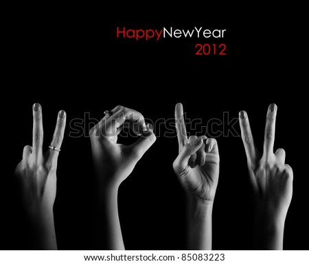 The number 2012 are shown via fingers in creative New Year greeting card - stock photo