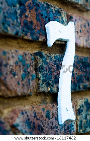 The number seven on a brick wall - stock photo