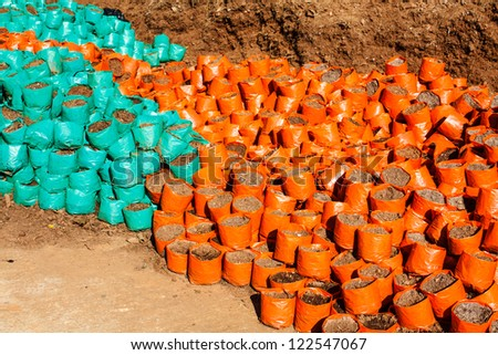 The Nursery bags and soil pile  for cultivate - stock photo