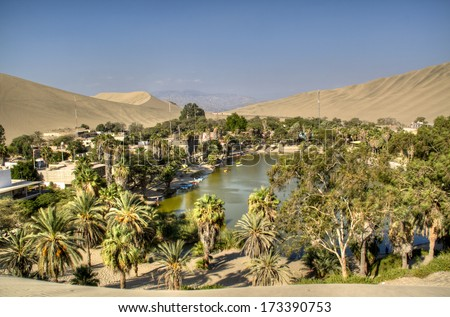 The oasis of Huacachina in the desert of Ica, Peru - stock photo