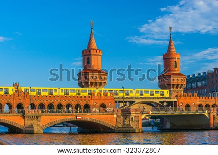 The Oberbaum Bridge,  / german Oberbaumbrucke / and River Spree in Berlin, Germany,  - stock photo