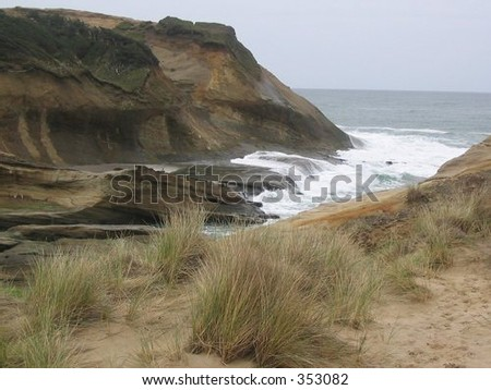 The ocean clashes with the beach at Pacific City, Ore. - stock photo