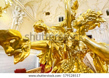 The Odessa National Academic Theater of Opera and Ballet in Ukraine. Golden Figure in the hall near upstairs. 06 Jan 2014 - stock photo